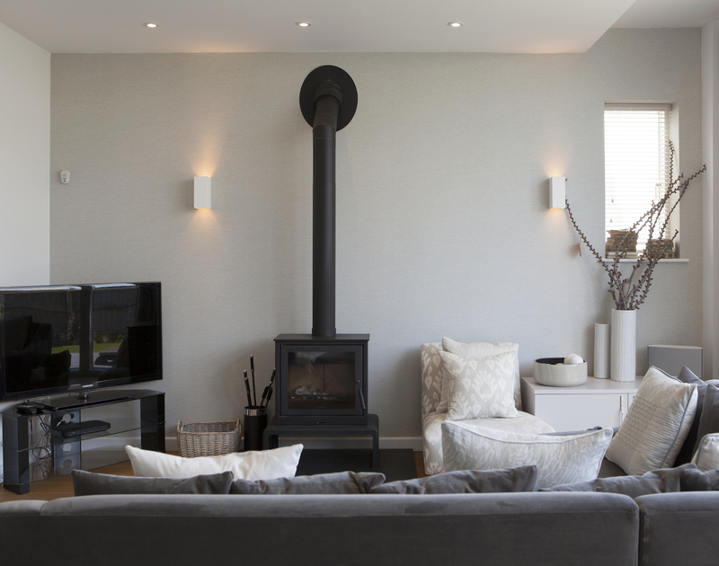 The large social living space where you can relax in front of the log burner, a luxury self catering holiday home in Polzeath, Cornwall.