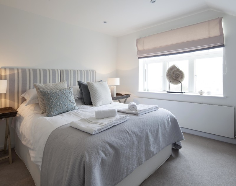 The contemporary double bedroom at 2 The Sands, a luxury self catering holiday home in Polzeath, Cornwall.