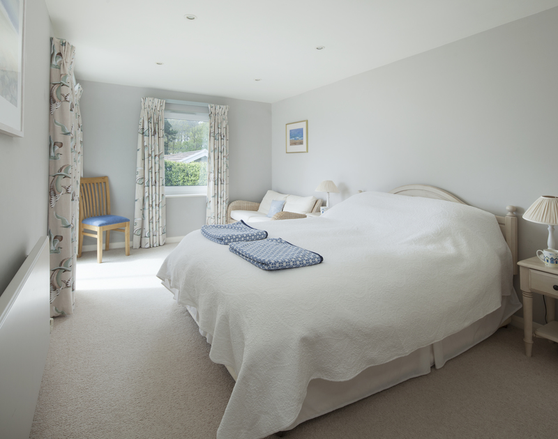 A balcony opens out from the double master bedroom at 4 The Anchorage, a self catering holiday home in Rock.