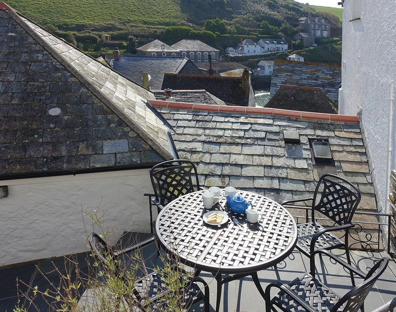The grey/blue slate roofed old fisherman's cottages running down towards the working fishing harbour of Port Isaac in North Cornwall from the suntrap patio area at Bre Cottage.