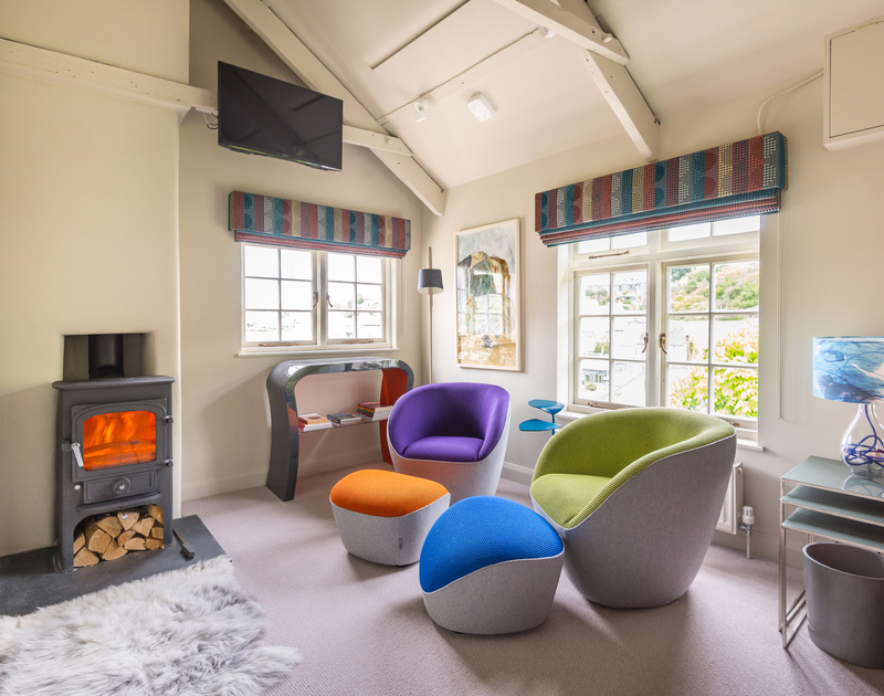 Light up the contemporary wood burner on low season holidays and warm up in the vibrant sitting room at Crows Nest, a holiday rental in Port Isaac.