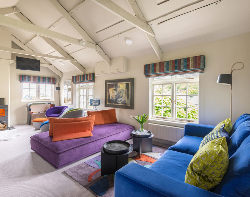 Eclectic colours and contemporary furnishings in the sitting room at Crows Nest, a self catering holiday cottage close to the harbour in Port Isaac.
