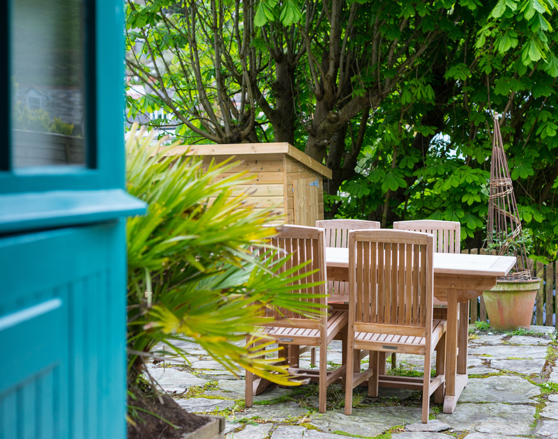Enjoy drinks or alfresco meals on the slate paved courtyard garden at Crow's Nest, a luxury self catering holiday cottage in Port Isaac.