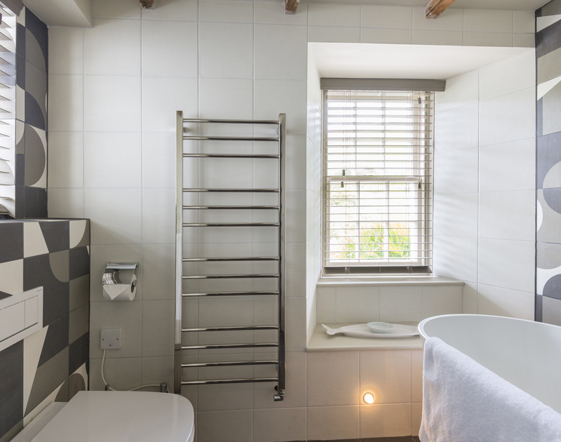 Lots of natural daytime light and a subtle lighting scheme in the bathroom at Crow's Nest a self catering holiday cottage in Port Isaac in Cornwall.