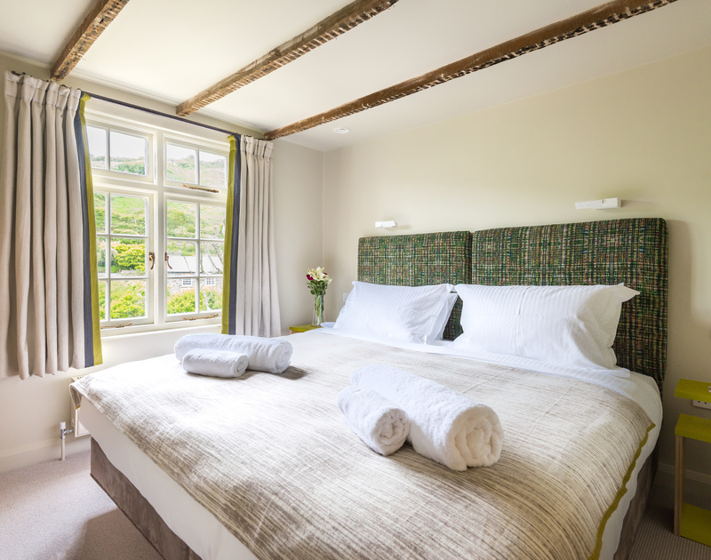 Relax in the sumptuous super king sized bed at Crow's Nest, a self catering holiday cottage in the seaside village of Port Isaac in North Cornwall.