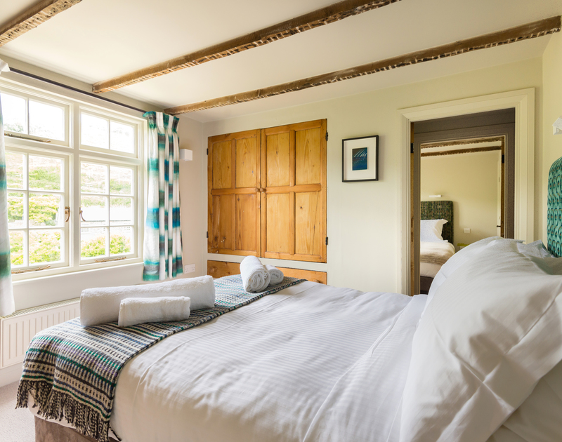 Lots of natural Cornish light flooding into the double bedroom at Crow's Nest, a self catering, fishermans cottage to rent in the seaside village of Port Isaac in North Cornwall.
