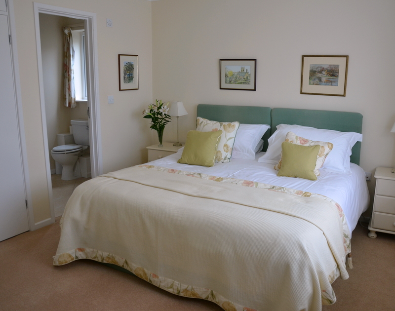 The light-filled double bedroom in Trewin, a self catering holiday property to rent in Rock, Cornwall.