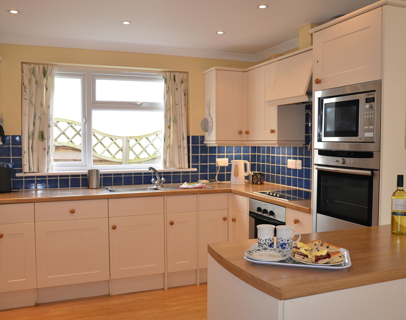 The contemporary well equipped kitchen in Trewin, a self catering holiday bungalow in Rock.