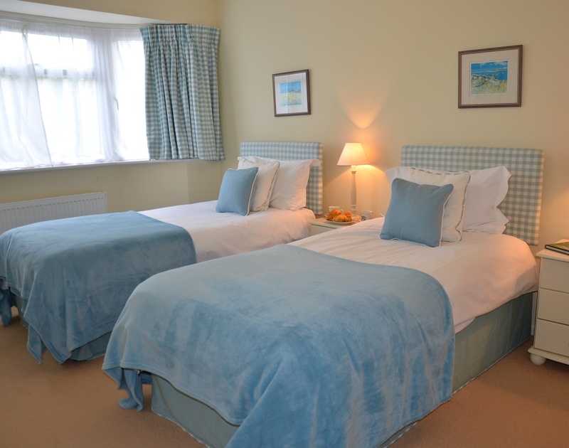 One of the twin bedrooms in Trewin, Rock with cream/blue tones