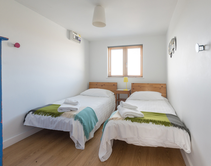 One of two twin bedrooms at self catering holiday accommodation to rent in Port Isaac in North Cornwall.