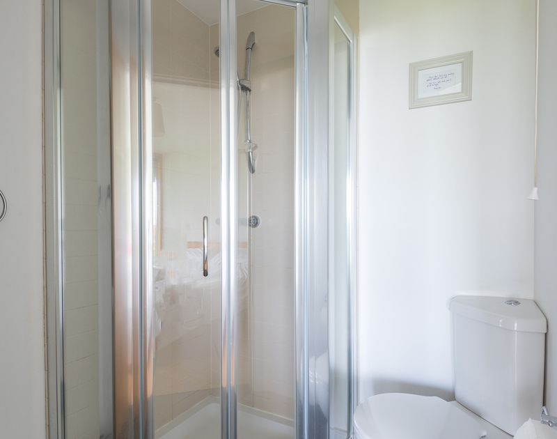 The ensuite shower room for the double bedroom on the ground floor at North Light, a self catering holiday house to rent in Port Isaac in North Cornwall.