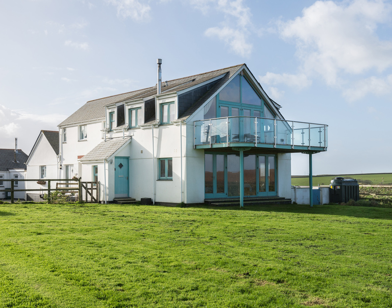 The exterior of self catering holiday accommodation North Light set in an elevated location above the picturesque village of Port Isaac on the North Cornish Coast.