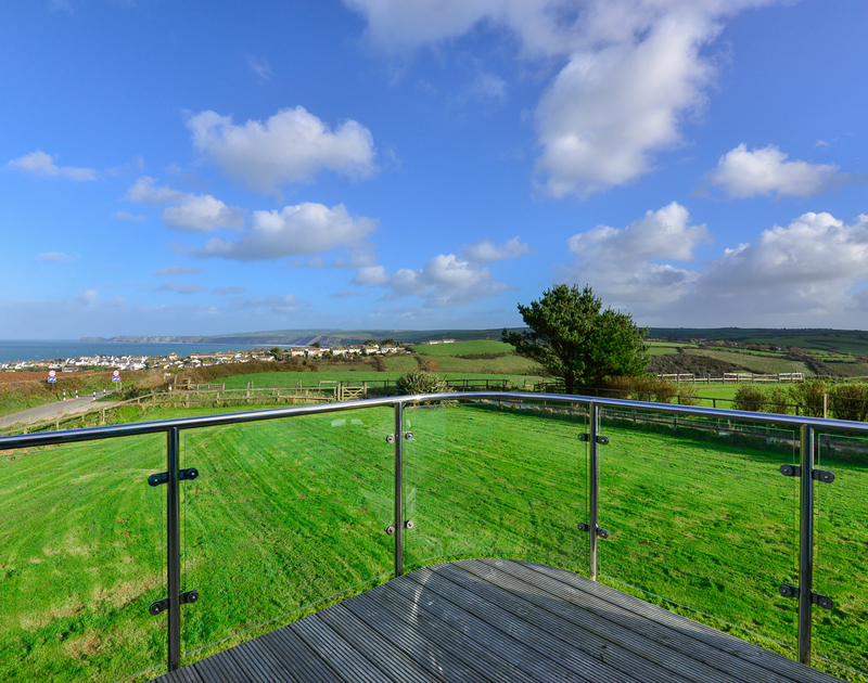 The large decked balcony off the open plan first floor at self catering North Light with panoramic rural and coastal views on the North Cornish Coast.