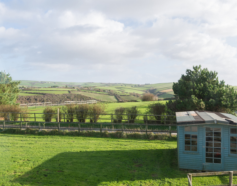Room for the kids to let off steam in the garden which is surrounded by a picket fence at North Light, self catering holiday accommodation overlooking Port Isaac in Cornwall.