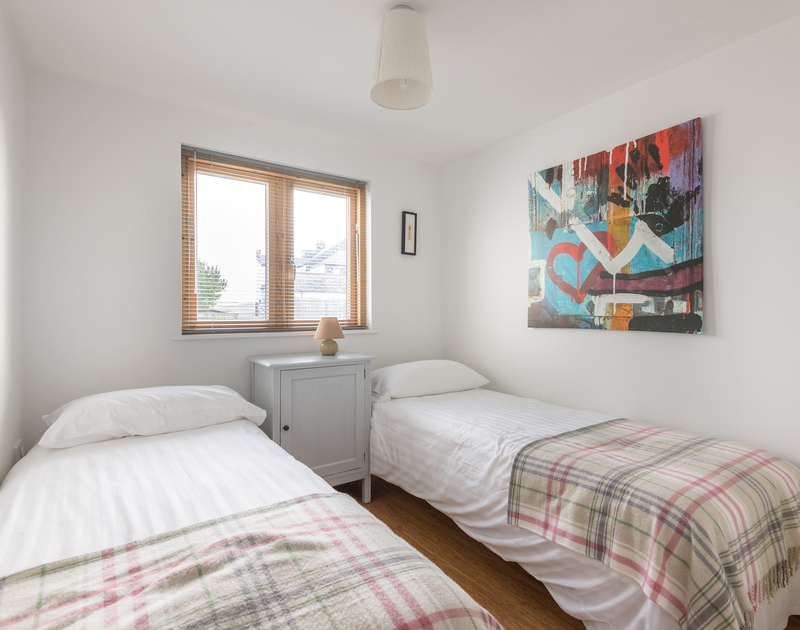 The second twin bedroom at North Light, a self catering holiday house overlooking picturesque Port Isaac on the North Coast of Cornwall.