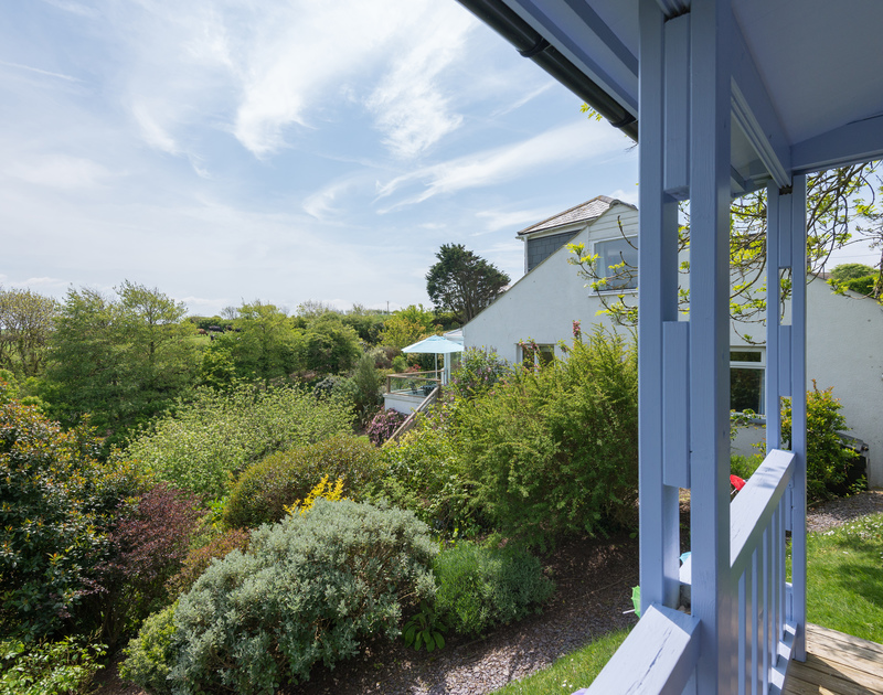Enjoy the garden views from the veranda of the summer house at self catering, holiday house to rent Sliggon Field in north Cornwall.