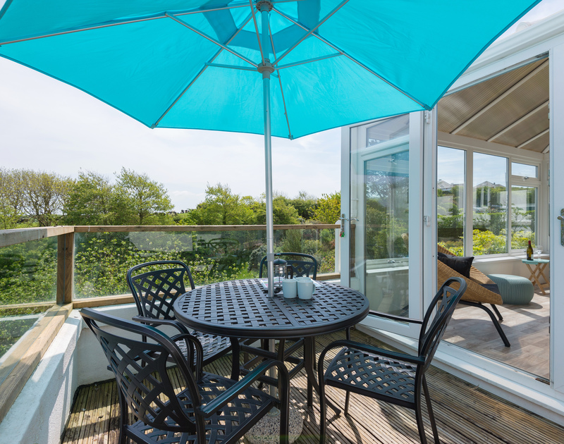 Accessed from the conservatory is a decked terrace overlooking the beautiful gardens at Sliggon Field in north Cornwall.