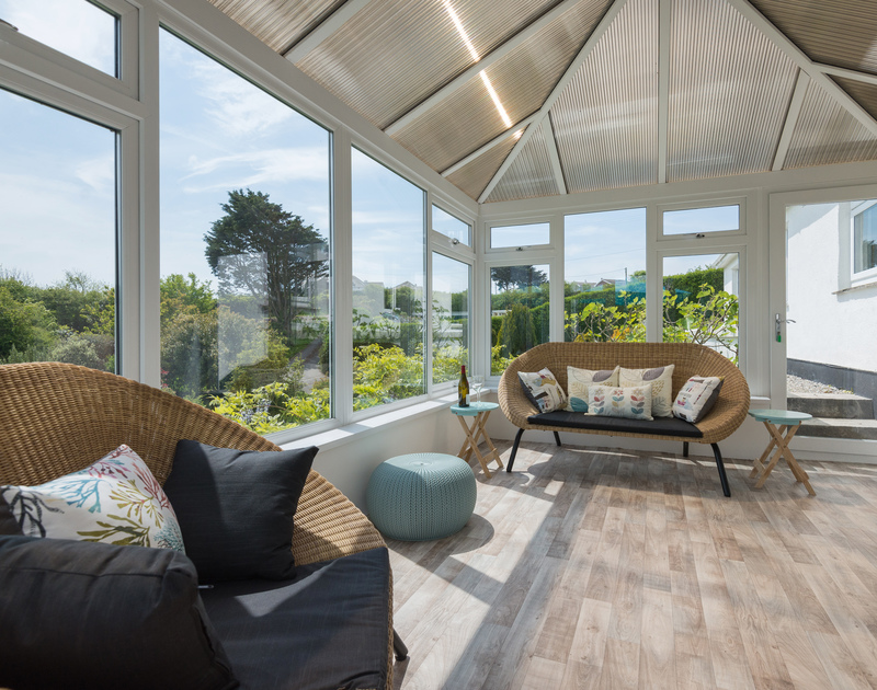 Relax and enjoy the Cornish light and fabulous views from the conservatory at Sliggon Field, close to the beaches, surf and shops at Polzeath and Daymer Bay.