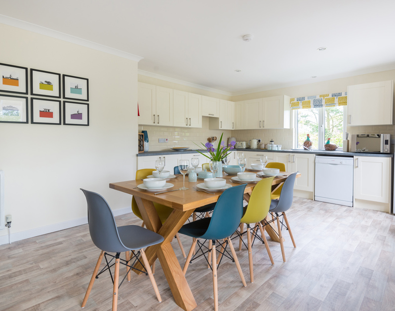 Funky coloured chairs in the open plan kitchen/dining room at Sliggon Field in Trebetherick.