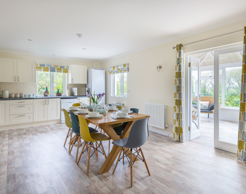 Light floods into the well equipped kitchen at self catering, Sliggon Field, a stunning family holiday property close to the north Cornish coast.