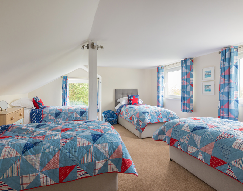 Fun for the kids big or small in the spacious quad bedroom at Sliggon Field with four twin beds and views over the gardens.
