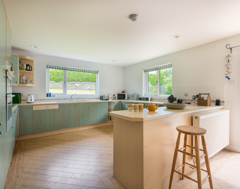 Well equipped, fitted kitchen at Tringa, a self catering, holiday house to rent within walking distance of Daymer Bay in north Cornwall.