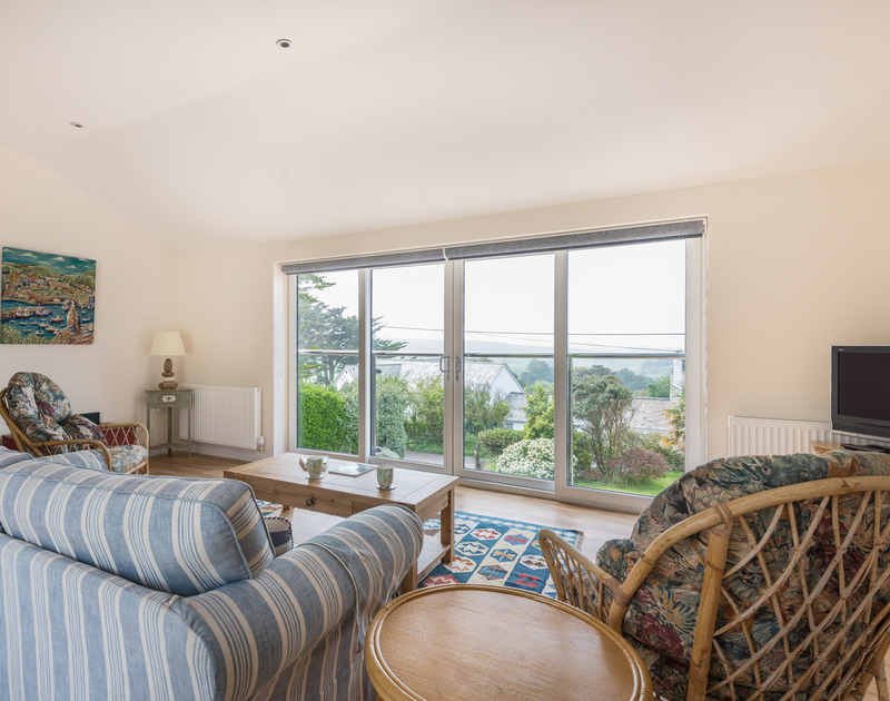 Take time to relax in the drawing room and admire the views from Tringa a self catering, holiday house in Daymer Bay in north Cornwall.