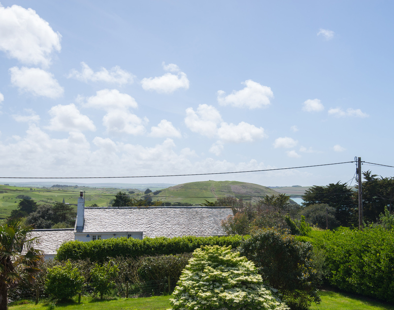 Brea Hill, and a glimpse of the Camel Estuary from self catering holiday house Tringa set above Daymer Bay.