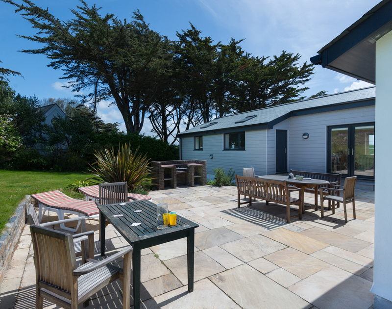 Enjoy family barbeques on the huge terrace after busy days on the beach at Daymer, just a short walk away from Tringa.