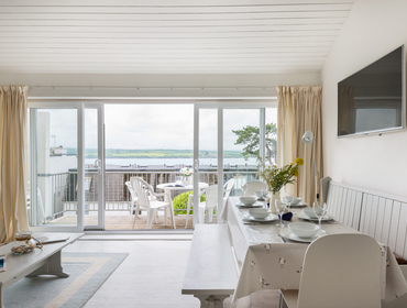 The open plan kitchen and sitting room at Slipway 10, with it stylish grey furnishings.