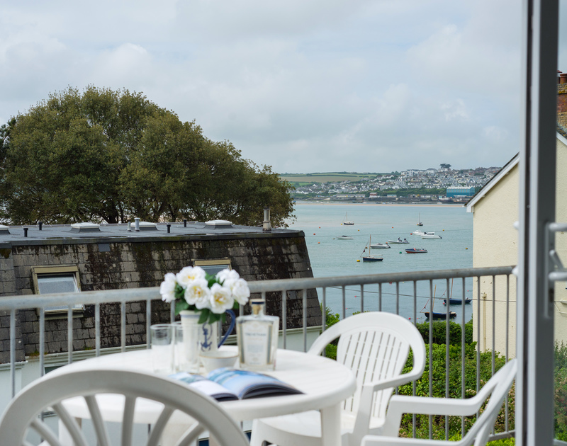 Enjoy a cream tea with a view on the terrace of Slipway 10, a holiday cottage in Rock
