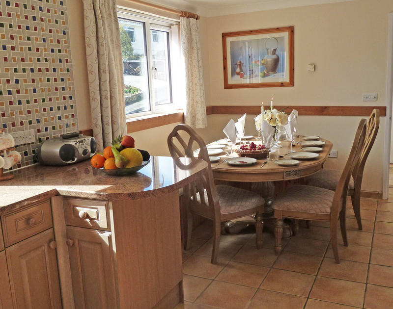 The bright and colourful kitchen/dining room at Penina, a self catering holiday house to rent in Polzeath, Cornwall.