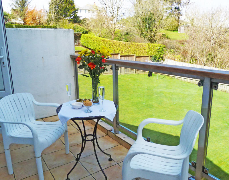 The balcony with rural views at Penina, a self catering holiday house to rent in Polzeath, North Cornwall.