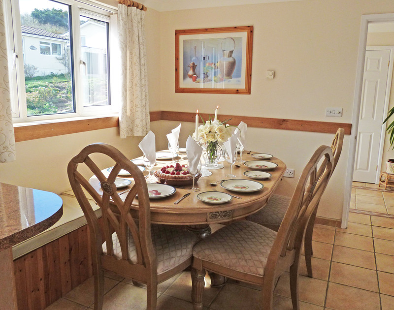 The dining table in the open plan kitchen/dining room at Penina, a family holiday house to rent in Polzeath in Cornwall.
