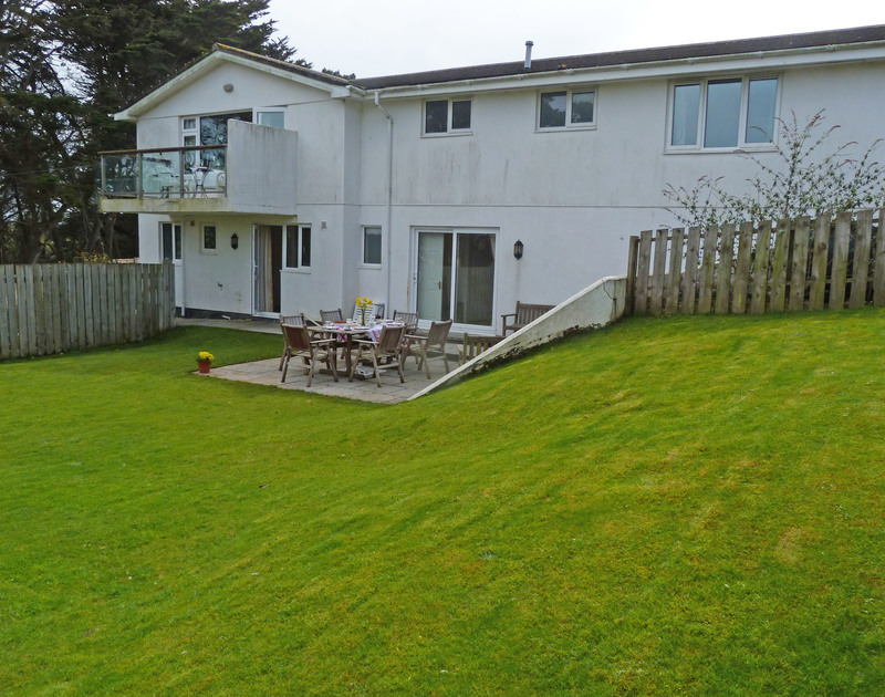 Great  lawned garden and paved terrace at Penina, a self catering holiday house to rent in Polzeath.