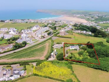 An aerial view of Sliggon-Field a South Facing self catering holiday house with large sunny grounds, situated in-between Daymer Bay and Polzeath, Cornwall