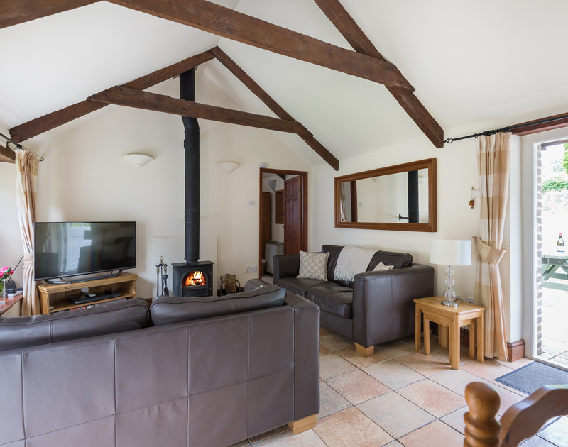 Eye catching vaulted ceiling with the original beams in the comfortable sitting room at Millers Cottage, a self catering holiday retreat near St Minver.