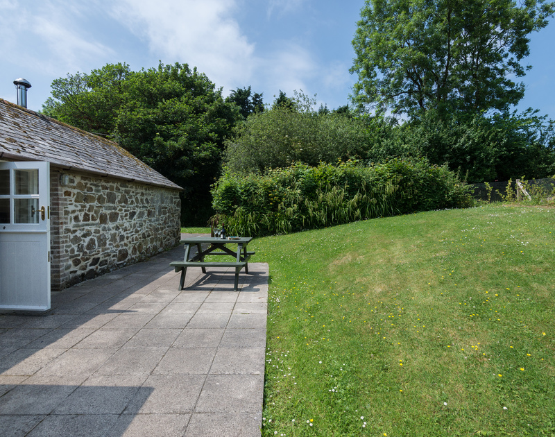 Plenty of outside space with a good sized lawn and patio area at Millers Cottage near St Minver in North Cornwall.