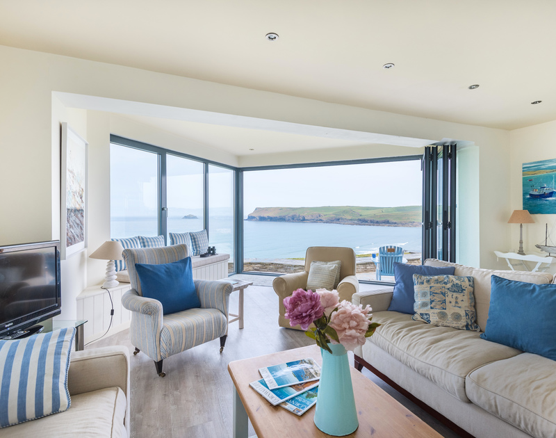 The panoramic sea views towards Newland and Pentire point at sunset from Treviles, a superbly positioned holiday house at Polzeath on The North Cornish Coast