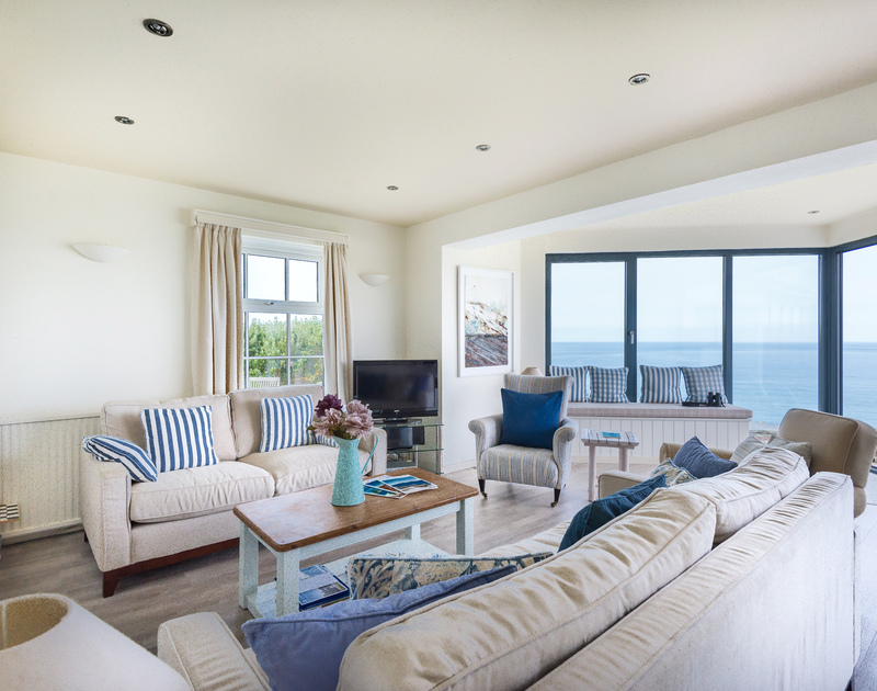The luxurious lounge with stunning sea views at Treviles, a holiday rental in Polzeath, Cornwall.