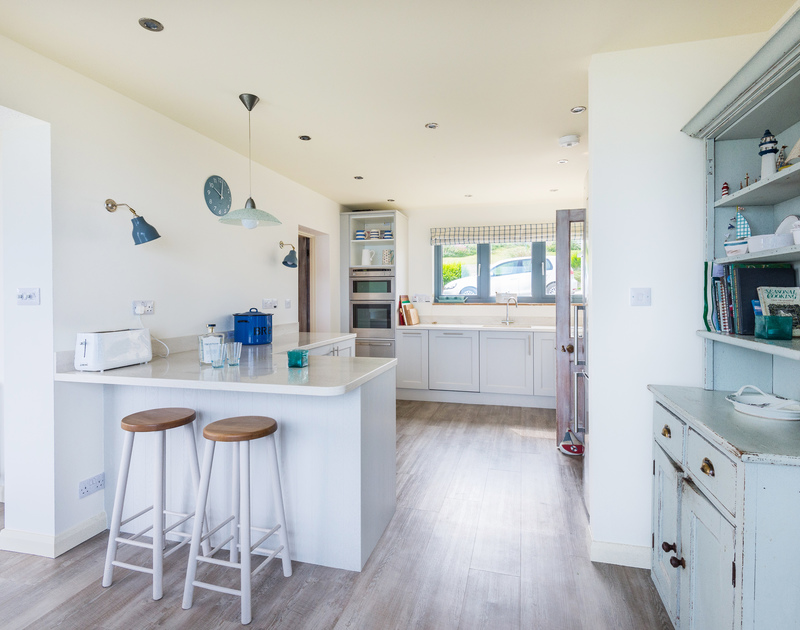 Convenient breakfast bar in the kitchen at coastal, holiday retreat Treviles, overlooking Polzeath in north Cornwall.