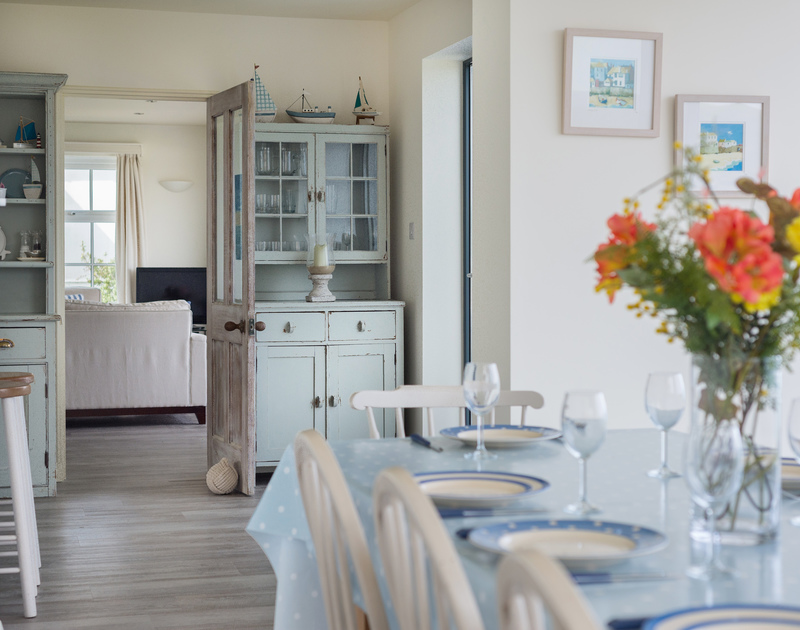 The welcoming kitchen and dining room at cliff top holiday property, Treviles, in Polzeath on the North Cornish Coast.
