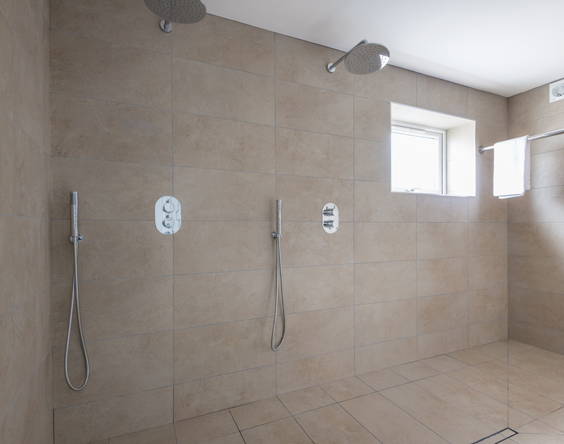 Plenty of room in the enormous dual shower room at Tradewinds in Polzeath, Cornwall.