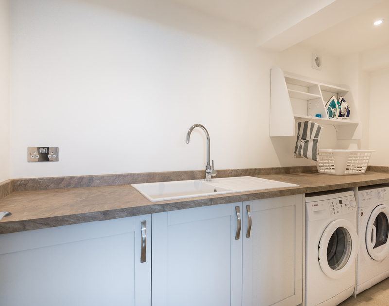 Perfectly appointed utility room at holiday property Tradewinds.