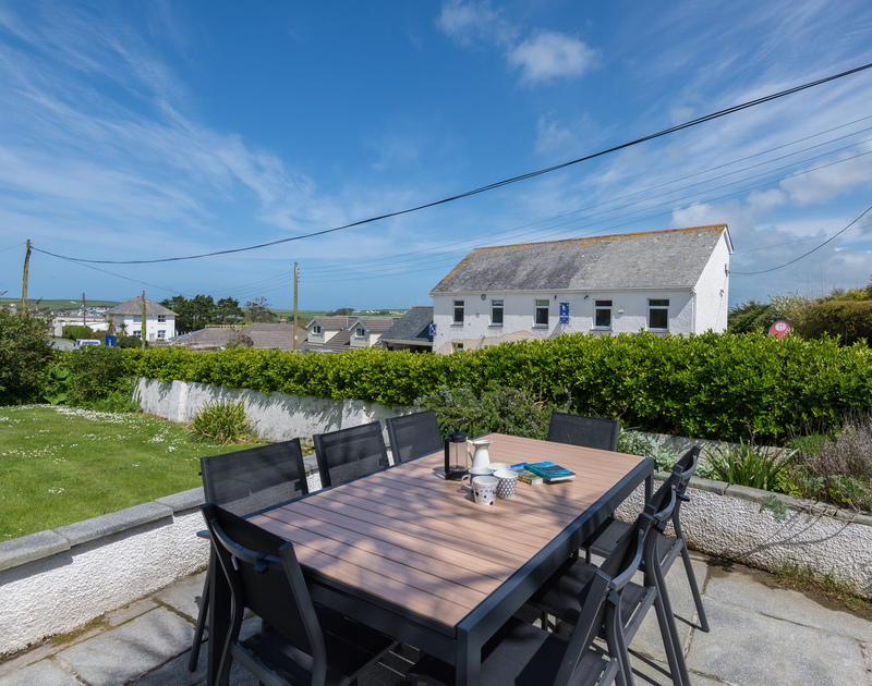 Plenty of outside space and Cornish sunshine in the garden at Tradewinds, a contemporary holiday house in Polzeath, Cornwall.