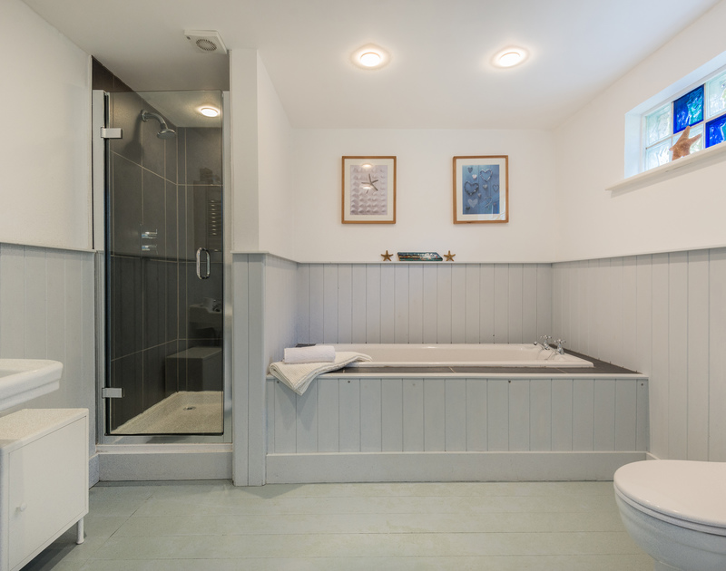 Interior family bathroom with walk in shower at self catering holiday property, Tradewinds in Polzeath, Cornwall.