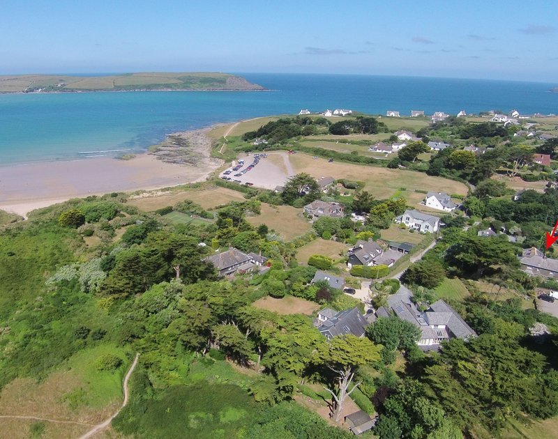 A high aerial view looking over to Stepper, showing Daymer Bay beach around too the Greenaway with the location marked with a red ring of Torquil, a stunning holiday house of Daymer Bay, Cornwall, with the beach in walking distance.