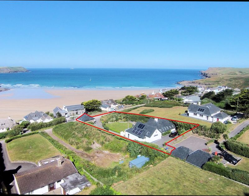 An aerial view of Clouds Hill, a fantastic newly constructed self-catering holiday house with large gardens and parking and footpath to the beach at New Polzeath, Cornwall