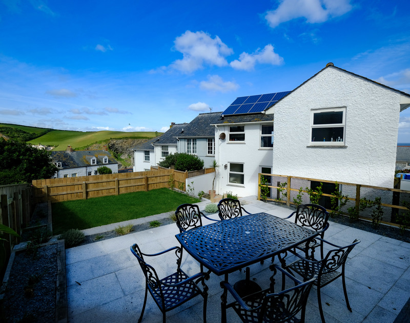 The sunny sheltered rear patio at Shilling Stones, Port Isaac which is perfectly located with parking and sea views in the upper part of the village.