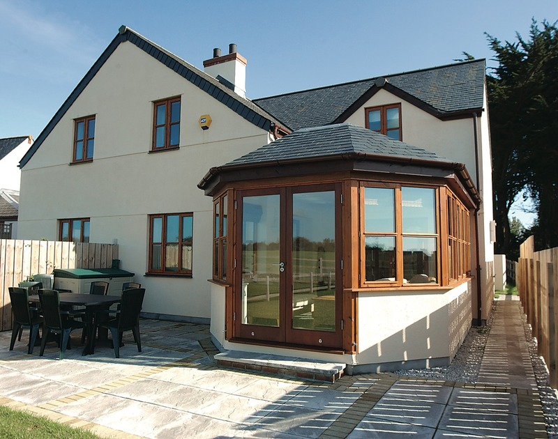 The external view from the garden of Puffin Cottage, a self catering holiday house to rent in Rock, Cornwall.